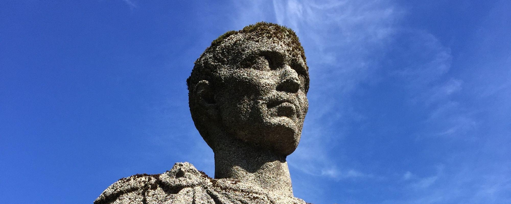 Upwards detail of a bust statue of a man