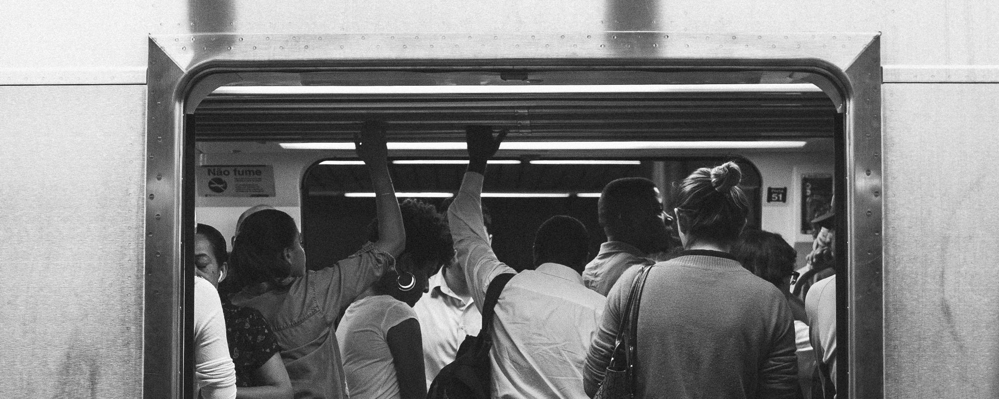 People crowding in a subway car
