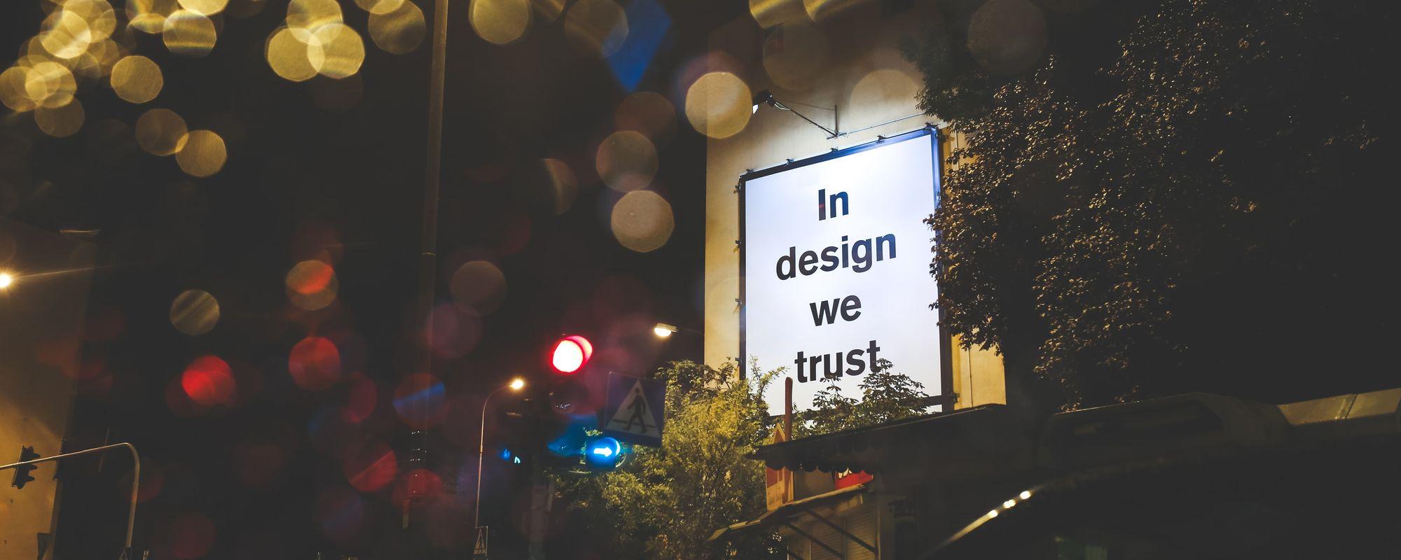 """Reclamă outdoor pe care scrie """"In design we trust"""""""